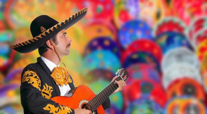 Cantante de rancheras con guitarra 696x385 Home